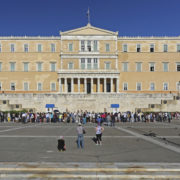 ATHENS, GREECE - MAY 04: Greek Parliament in Athens on MAY 04, 2015. Bunch of Tourists in front of Hellenic Parliament Building in Athens, Greece.